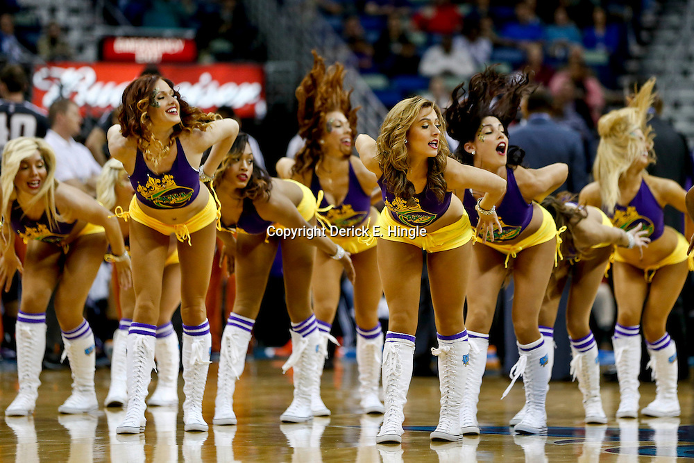 Feb 6, 2013; New Orleans, LA, USA; New Orleans Hornets Honeybees dance team perform during the second half of a game against the Phoenix Suns at the New Orleans Arena. The Hornets defeated the Suns 93-84. Mandatory Credit: Derick E. Hingle-USA TODAY Sports