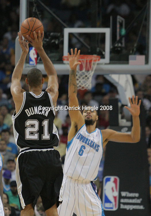 17 December 2008:  San Antonio Spurs forward Tim Duncan (21) shoots over New Orleans Hornets center Tyson Chandler (6) during a NBA regular season game between the Western Conference rivals the San Antonio Spurs and the New Orleans Hornets at the New Orleans Arena in New Orleans, LA..