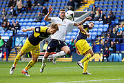 Charlie Raglan gets a head on the ball just before Bolton's Gary Madine  during the EFL Sky Bet League 1 match between Bolton Wanderers and Oxford United at the Macron Stadium, Bolton, England on 1 October 2016. Photo by Craig Galloway.