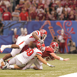 2 January 2009: Utah defenders Stevenson Sylvester (10), and Kepa Gaison (59) sack Alabama quarterback John Parker Wilson (14) to end the first half of the 75th annual All State Sugar Bowl  between the Utah Utes and the Alabama Crimson Tide at the Louisiana Superdome in New Orleans, LA.
