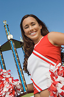 Cheerleader Holding Trophy