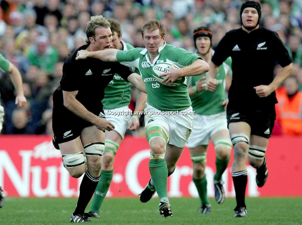 Anthony Horgan of Ireland breaks from Jason Eaton of New Zealand during the Rugby Union test match between Ireland and the All Blacks at Landsdowne Road, Dublin, Saturday 12 November 2005.The All Blacks won the match 45-7. Photo: INPHO/Photosport.<br /><br /><br /><br />139488