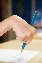 Pupil with brain injury writing,
