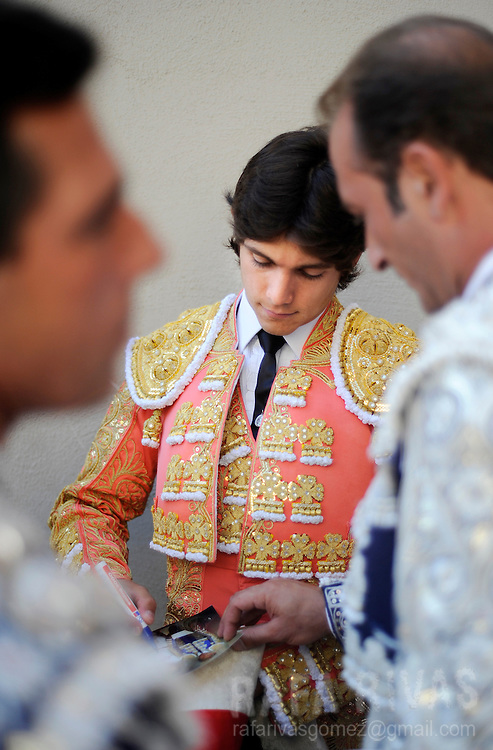 French bullfighter Sebastian Castella signs an autograph at the Pamplona bull-ring prior to fight two Fuente Ymbro fighting bulls, on July 9, 2008, in the Spanish city of Pamplona, during the thirth corrida of the San Fermin festivities.