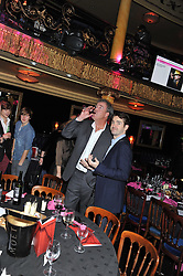 Left to right, JEREMY CLARKSON and JIMMY CARR at the Hoping Variety Show - A benefit evening for Palestinian Refugee Children held at The Cafe de Paris, Coventry Street, London on 21st November 2011.