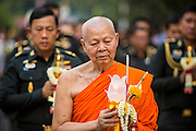 "25 FEBRUARY 2013 - BANGKOK, THAILAND:   A monk leads a procession of Thai soldiers around Wat Benchamabophit Dusitvanaram (popularly known as either Wat Bencha or the Marble Temple) on Makha Bucha Day. Makha Bucha is a Buddhist holiday celebrated in Myanmar (Burma), Thailand, Cambodia and Laos on the full moon day of the third lunar month (February 25 in 2013). The third lunar month is known in Thai is Makha. Bucha is a Thai word meaning ""to venerate"" or ""to honor"". Makha Bucha Day is for the veneration of Buddha and his teachings on the full moon day of the third lunar month. Makha Bucha Day marks the day that 1,250 Arahata spontaneously came to see the Buddha. The Buddha in turn laid down the principles his teachings. In Thailand, this teaching has been dubbed the 'Heart of Buddhism'.    PHOTO BY JACK KURTZ"