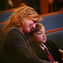 Kyle Green | The Roanoke Times<br /> January 30, 2008 Allison Hudler holds son, Cole Hudler (right, age 6), after the funeral services for Ron and Fred Hudler held Wednesday at the Boone Family Funeral Home in West Jefferson, North Carolina. Fred, Cole's dad and Allison's husband; and his father, Ron Hudler, were murdered along with an employee of their Christmas tree farm on Thursday. Police have arrested Frederick Phillip Hammer for the murders, which police suspect were motivated by robbery.