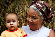 Grandmother with granddaughter on a farm in Vega Yumuri, near La Maquina, Guantanamo Province, Cuba.