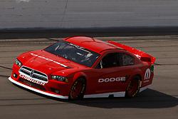 Mar 11, 2012; Las Vegas, NV, USA;  The 2013 Dodge Charger drives through turn 1 before the Kobalt Tools 400 at Las Vegas Motor Speedway. Mandatory Credit: Jason O. Watson-US PRESSWIRE