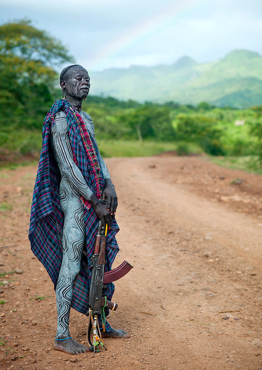 Suri man with a Kalashnikov in Turgit village, Omo valley, Ethiopia.<br />