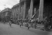 The Annual Commemorative Easter Army Parade. The National flag and the Colour Party passing the reviewing stand at the G.P.O. as the President Eamon de Valera takes the salute..18.04.1965