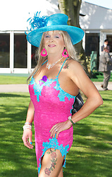 "LIVERPOOL, ENGLAND, Thursday, April 7, 2011: Transvestite ""Paula"" during Ladies' Day on Day Two of the Aintree Grand National Festival at Aintree Racecourse. (Photo by David Rawcliffe/Propaganda)"