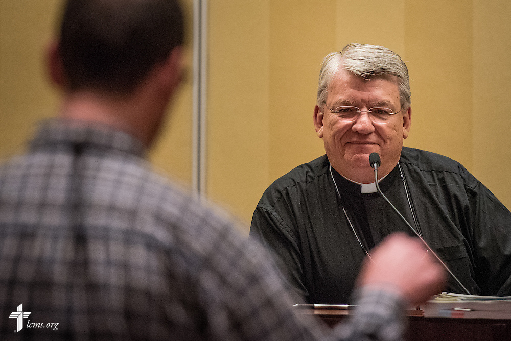 """The Rev. Dr. John Wille, president of the LCMS South Wisconsin District, listens during an open hearing of Floor Committee #12 """"Ecclesiastical Supervision and Dispute Resolution"""" at the 66th Regular Convention of The Lutheran Church–Missouri Synod on Saturday, July 9, 2016, in Milwaukee. LCMS/Michael Schuermann"""