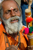 "India, Nasik, 2006. A ""sadhu'"" or traveling holy man, sings for his supper at the Ramkund, pilgrimage site for many religious Hindus."