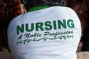 Ghana: 25 April 2012, Back of a t-shirt worn by a nurse in Dodowa.The GAVI Alliance is a public-private partnership that brings together developing country and donor governments, WHO, UNICEF, the World Bank, the vaccine industry in both industrialised and developing countries, research and technical agencies, civil society, the Bill & Melinda Gates Foundation and other private philanthropists.  Set up in 2000 as the Global Alliance for Vaccines and Immunisation, GAVI's mission is to save children's lives and protect people's health by increasing access to immunisation in the world's poorest countries.
