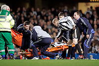 Photo: Marc Atkins.<br /> Chelsea v Newcastle United. The Barclays Premiership. 13/12/2006. Charles N'Zogbia of Newcastle is comforted by Peter Ramage as he is carried off injured.