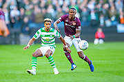 Scott Sinclair(#11) of Celtic FC and Arnaud Djoum (#10) of Heart of Midlothian during the Betfred League Cup semi-final match between Heart of Midlothian FC and Celtic FC at the BT Murrayfield Stadium, Edinburgh, Scotland on 28 October 2018.