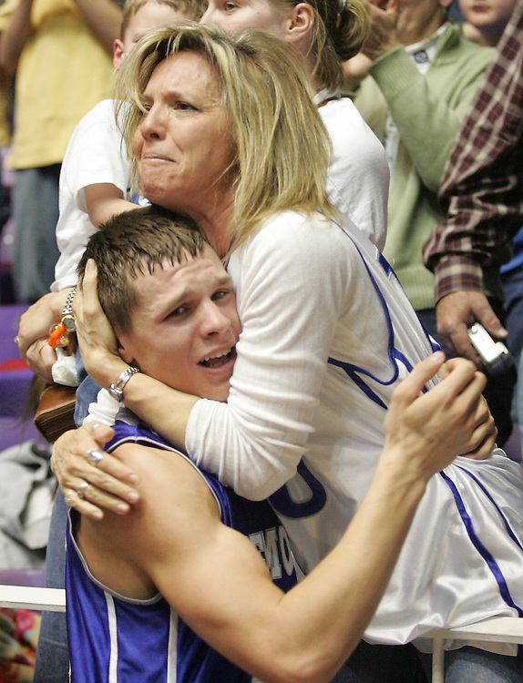 Fremont's Trevor Highley and his mom Tammy celebrate Fremont's win over West Jordan for the 5A boys state basketball championships at the Dee events center in Ogden, Utah Saturday, March 5, 2005. August Miller/ Deseret Morning News DIGITAL PHOTOGRAPH