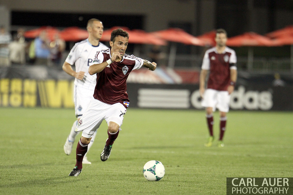 August 17th, 2013 - Colorado Rapids forward Vicente Sánchez (7) drives the ball up the field in the second half of action in the Major League Soccer match between the Vancouver Whitecaps FC and the Colorado Rapids at Dick's Sporting Goods Park in Commerce City, CO