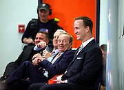 SHOT 3/20/12 2:04:07 PM - Pat Bowlen, center, reacts to a humorous question as the Denver Broncos introduced free agent quarterback Peyton Manning, right, at team headquarters in Englewood, Co. at a press conference on Tuesday Marc 20, 2012. Manning is coming off neck surgery and was released by the Indianapolis Colts. He signed a five year, $96 million contract with the Broncos..(Photo by Marc Piscotty / © 2012)