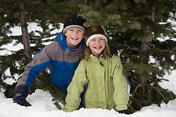 United States, Washington, Crystal Mountain, brother and sister in snow.  MR