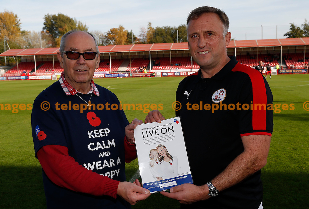 Crawley&rsquo;s Manager Mark Yates poppy appeal donation during the Sky Bet League 2 match between Crawley Town and York City at the Checkatrade.com Stadium in Crawley. October 31, 2015.<br /> James Boardman / Telephoto Images<br /> +44 7967 642437