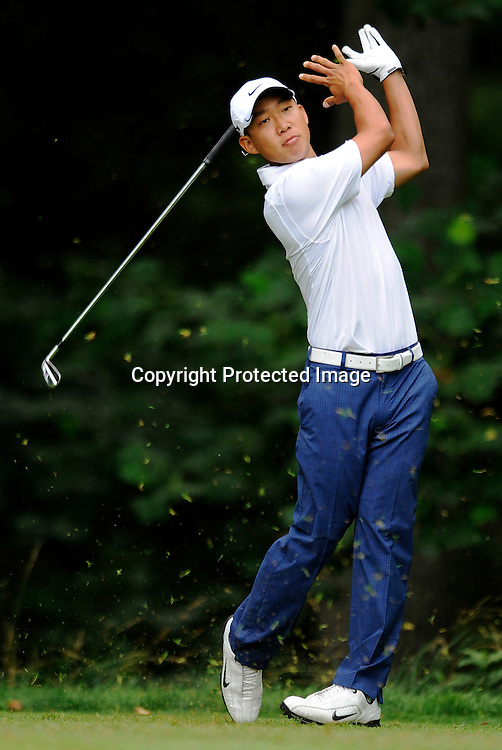 Anthony Kim lets go of his club during his tee shot on the 13th hole during the second round of the AT&T National PGA golf tournament at Congressional Country Club in Bethesda, Maryland.