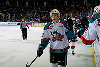 KELOWNA, CANADA - JANUARY 9: Lassi Thomson #2 of the Kelowna Rockets skates by the bench and fist bumps teammates to celebrate a goal against the Everett Silvertips  on January 9, 2019 at Prospera Place in Kelowna, British Columbia, Canada.  (Photo by Marissa Baecker/Shoot the Breeze)