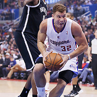16 November 2013: Los Angeles Clippers power forward Blake Griffin (32) drives past Brooklyn Nets center Andray Blatche (0) during the Los Angeles Clippers 110-103 victory over the Brooklyn Nets at the Staples Center, Los Angeles, California, USA.