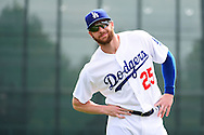 GLENDALE, AZ - MARCH 05:  Corey Brown #25 of the Los Angeles Dodgers stretches prior to the spring training game against the Arizona Diamondbacks at Camelback Ranch on March 5, 2016 in Glendale, Arizona.  (Photo by Jennifer Stewart/Getty Images) *** Local Caption *** Corey Brown