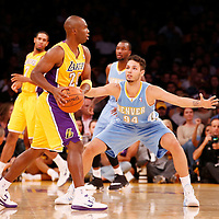 06 October 2013: Denver Nuggets shooting guard Evan Fournier (94) defends on Los Angeles Lakers shooting guard Jodie Meeks (20) during the Denver Nuggets 97-88 victory over the Los Angeles Lakers at the Staples Center, Los Angeles, California, USA.