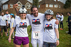 © Licensed to London News Pictures. 06/03/2016. Dorking, UK. Competitor JOEL HICKS with the two 'wives' he was carrying at the Finnish line after taking part in the 2016 Wife Carrying Race in Dorking, Surrey.  The race, which is run over a course of 380m, with both men and women carry a 'wife' over obstacles,  is believed to have originated in the UK over twelve centuries ago when Viking raiders rampaged into the northeast coast of  England carrying off any unwilling local women .  Photo credit: Ben Cawthra/LNP
