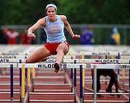 14 MAY 2011 -- ST. LOUIS -- Parkway West High School runner Nicole Douglas clears the final hurdle in the girls' 100-meter hurdles during the MSHSAA Class 4, District 2 track meet at Eureka High School in Eureka, Mo. Saturday, May 14, 2011. Image © copyright 2011 Sid Hastings.