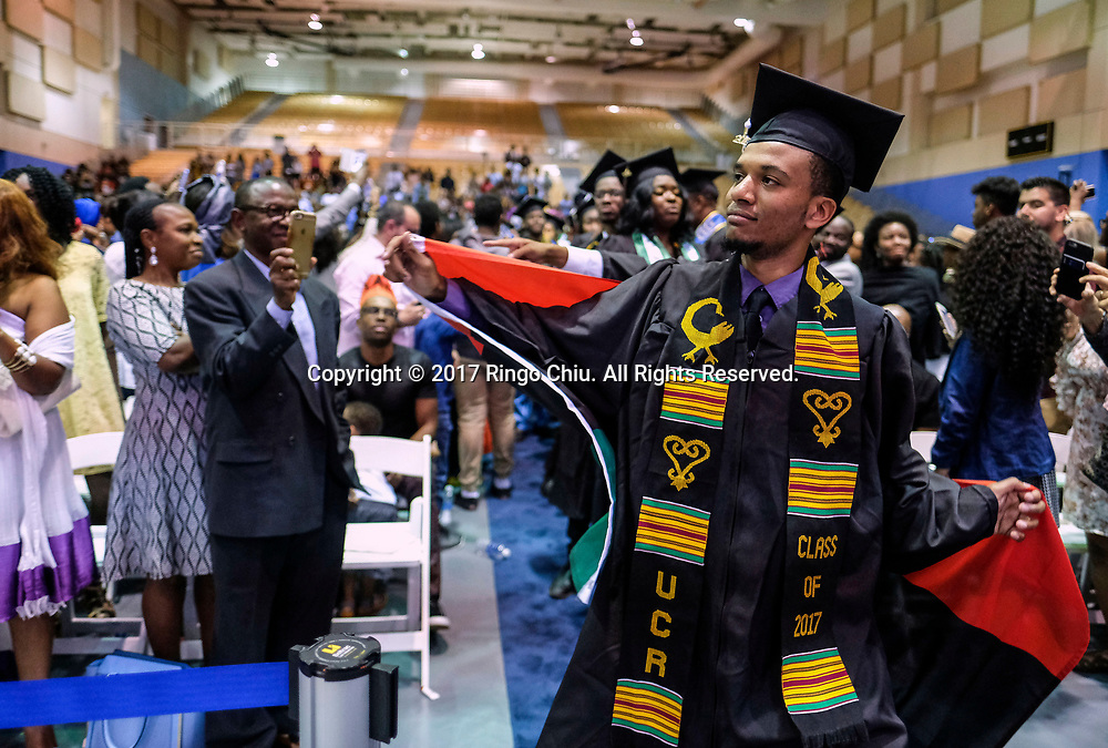 RIVERSIDE, CA - JUNE 11, 2017: Graduate Alexander Wilson dances in the Black Graduation Ceremony at University of California, Riverside, Sunday June 11, 2017. (Photo by Ringo H.W. Chiu / For The Times)(Photo by Ringo Chiu)<br /> <br /> Usage Notes: This content is intended for editorial use only. For other uses, additional clearances may be required.