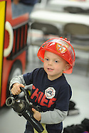 Liam Kulp, 4.5 years old, of Doylestown, Pennsylvania plays with a fire hose at the Doylestown Firehouse Open House Friday October 2, 2015 in Doylestown, Pennsylvania.  (Photo by William Thomas Cain)