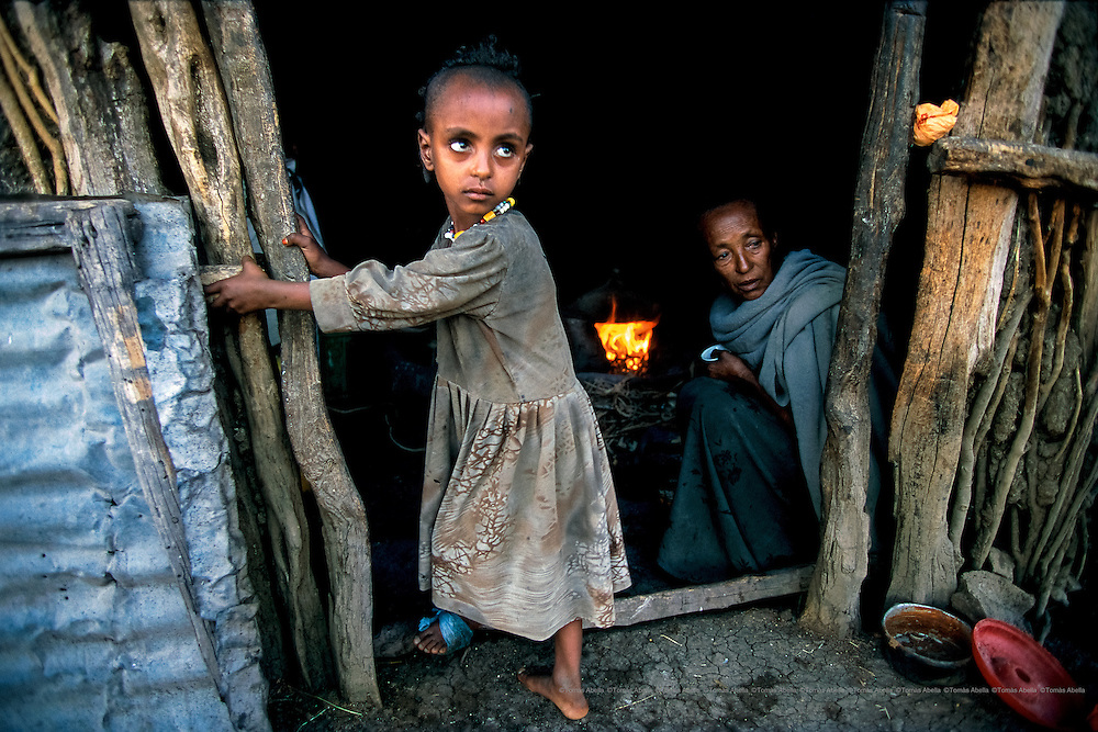 """In some of the small villages of Tigray, there are """"water beggars"""": old women and men without families or strength who travel from house to house begging for water.  Raya-Mehoni, Ethiopia."""