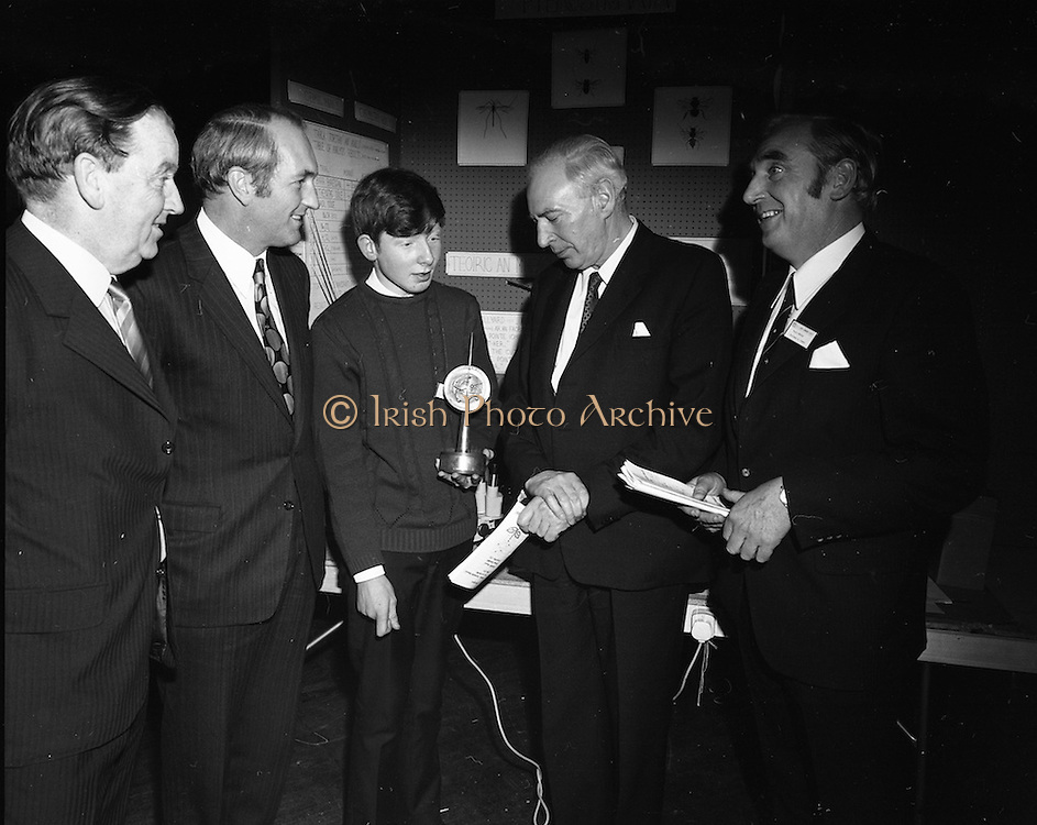 1972.07/01/1972.01/07/1972.7th January 1972.The Aer lingus Young Scientist Exhibition at the RDS, Dublin..Sean Mac Fheorais from Colaiste Mhuire, Cearnog Pharnell, Dublin showing his winning exhibit 'Grinn-staidear ar pterostigmata' to the Minister for Finance, George Colley (on his right) and Patrick Lynch, Chairman of Aer lingus (on his left).