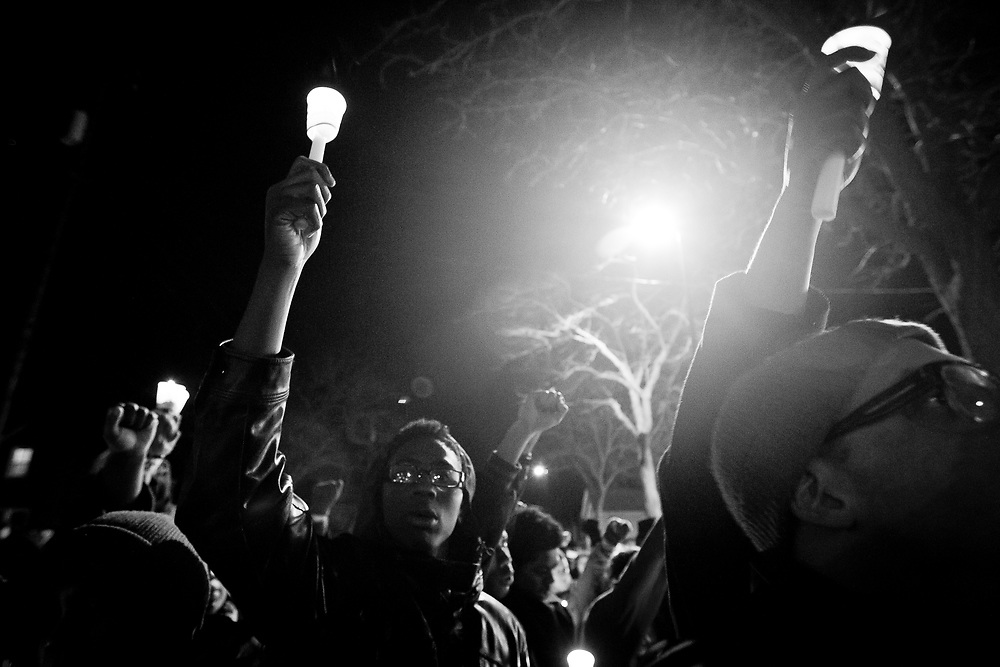 Marlon Ruffin holds a candle in the air during a candlelight vigil on Williamson Street on Sunday night for Tony Robinson, March 8, 2015. Robinson was an unarmed black teen shot on Friday by Madison Police inside his home. REUTERS/Ben Brewer (UNITED STATES)