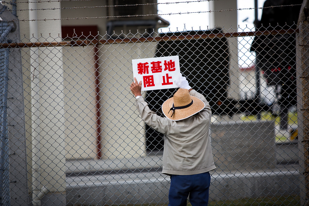 OKINAWA, JAPAN - NOVEMBER 17:  Anti U.S. Base protester shout with placards in front of the gate of U.S Marine Base in Camp Schwab, protesting against the construction of the new U.S base in Henoko, Nago, Okinawa prefecture, Japan on November 17, 2015. (Photo: Richard Atrero de Guzman)