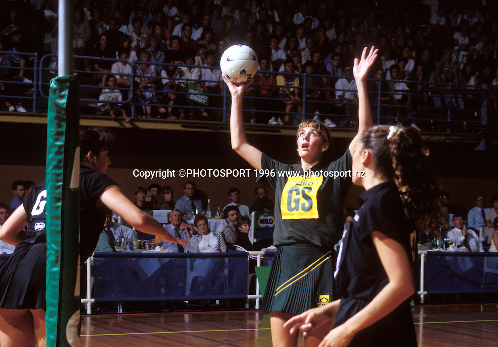 South Africa GS Irene van Dyk puts up a shot during the international netball match between New Zealand and South Africa, 1995. Photo: Bruce Jarvis/PHOTOSPORT