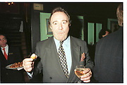 Dai Llewellen eating a chicken nugget. Lin Cook book launch, Tramp, Jermyn St. 1996© Copyright Photograph by Dafydd Jones 66 Stockwell Park Rd. London SW9 0DA Tel 020 7733 0108 www.dafjones.com