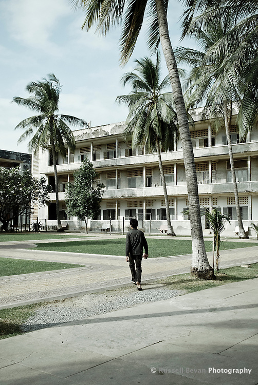 A man walks into the Tuol Sleng Genocide Museum complex in Phnom Penh, Cambodia