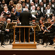 """March 6, 2012 - New York, NY : .Guest conductor Jon Oliver, standing in foreground, leads the Boston Symphony Orchestra featuring the Tanglewood Festival Chorus, in background, and, standing with sheet music from left to right, soprano Christine Brewer, mezzo-soprano Michelle DeYoung, tenor Simon O'Neill, and bass-baritone Eric Owens in Ludwig Van Beethoven's """"Missa solemnis in D Major, Op. 123 (1819-1823)' in Isaac Stern Auditorium at Carnegie Hall on Tuesday night..CREDIT : Karsten Moran for The New York Times"""