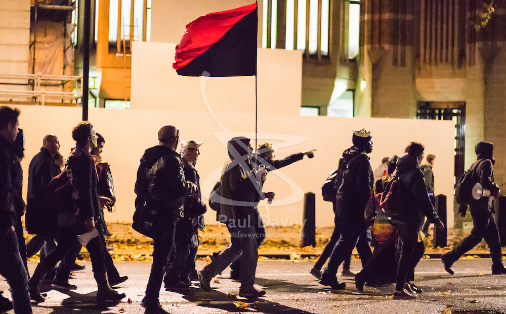 London, November 5th 2015.  Anarchists and anti-establishment activists hold their annual Million Mask March on Guy Fawkes night, enduring rain and a heavy police presence. The marches origins lie with the online activism group Anonymous. PICTURED:   // Licencing Contact: paul@pauldaveycreative.co.uk Mobile 07966 016 296