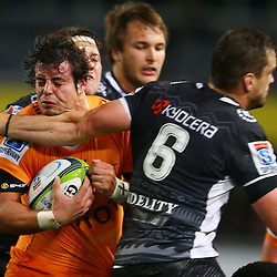 DURBAN, SOUTH AFRICA, 9,JULY, 2016 Keegan Daniel of the Cell C Sharks with a tackle on Francois Venter (captain) of the Toyota Cheetahs during The Cell C Sharks vs Toyota Cheetahs  Super Rugby Match at Growthpoint Kings Park in Durban, South Africa. (Photo by Steve Haag)<br /> <br /> images for social media must have consent from Steve Haag