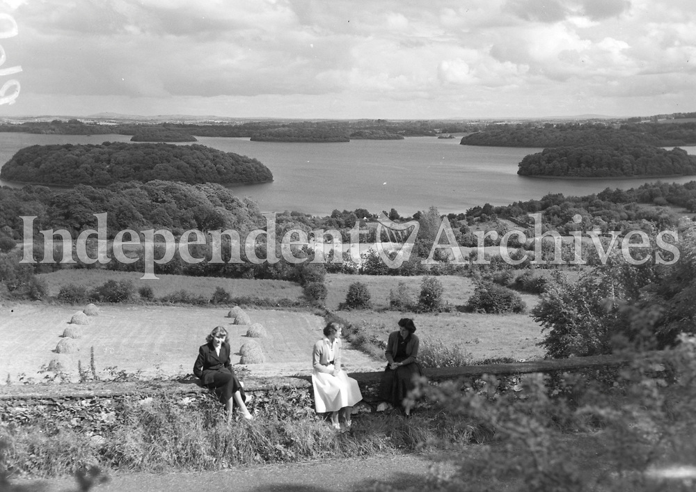 R602 Scenic Views: Cultivated farmland rolling down on the bank of island dotted Lough Key as seen from what is thought to be the Rock of Dooran, Boyle - Ballyfarnan Road. 17/08/53. (Part of the Independent Ireland Newspapers/NLI Collection)