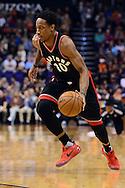 Dec 29, 2016; Phoenix, AZ, USA;  Toronto Raptors guard DeMar DeRozan (10) handles the ball in the first half of the NBA game against the Phoenix Suns at Talking Stick Resort Arena. The Suns won 99-91. Mandatory Credit: Jennifer Stewart-USA TODAY Sports