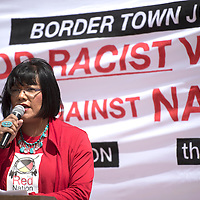040415      Cayla Nimmo<br /> <br /> Stella Johnson, a transgendered Dine and member of The Red Nation, gives a speech on the historic racism against native people in border towns such as Gallup during a rally outside of the Gallup Chamber of Commerce Saturday. The Red Nation, an Albuquerque based indigenous rights group, organized the demonstration including a march along Route 66.