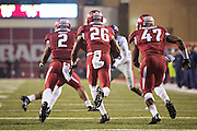 FAYETTEVILLE, AR - NOVEMBER 22:  Rohan Raines #26 of the Arkansas Razorbacks follows his blockers after intercepting a pass and running it back 100 yards for a touchdown against the Ole Miss Rebels at Razorback Stadium on November 22, 2014 in Fayetteville, Arkansas. The Razorbacks defeated the Rebels 30-0.   (Photo by Wesley Hitt/Getty Images) *** Local Caption *** Rohan Gaines
