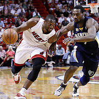 12 March 2011: Miami Heat shooting guard Dwyane Wade (3) drives past Memphis Grizzlies shooting guard Tony Allen (9) during the Miami Heat 118-85 victory over the Memphis Grizzlies at the AmericanAirlines Arena, Miami, Florida, USA. **